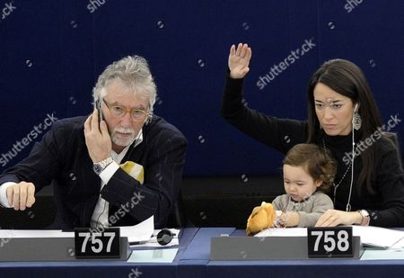 European Parliament Member Licia Ronzulli (r) of the Group of the European People's Party and Her Baby Participate in a Vote During the Plenary Session of the European Parliament in Strasbourg France 14 December 2011 France Strasbourg