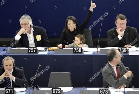 European Parliament Member Licia Ronzulli (c) of the Group of the European People's Party and Her Baby Participates in a Vote During the Plenary Session of the European Parliament in Strasbourg France 14 December 2011 France Strasbourg