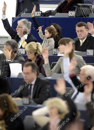 European Parliament Member Licia Ronzulli (obscured) of the Group of the European People's Party and Her Baby (c) Participate in a Vote During the Plenary Session of the European Parliament in Strasbourg France 14 December 2011 France Strasbourg
