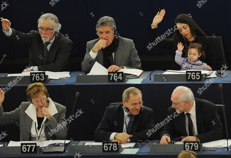 Italian Member of the European Parliament Licia Ronzulli (top R) Takes Part with Her Baby in a Voting Session in the European Parliament in Strasbourg in France 15 February 2012 the Mp's Are to Discuss the Greek Bailout Package Among Others France Strasbourg