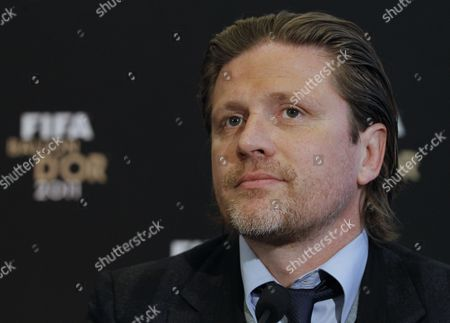 Stock Picture of France's Former Soccer Player Emmanuel Petit During the Press Conference to Announce the Nominees For the Fifa Ballon D'or 2011 in Boulogne-billancourt Near Paris France 05 December 2011 Lionel Messi is on Course to Win a Third Successive World Player of the Year Award After the Argentina International was Named As One of Three Candidates For the Ballon Dor Messi was Nominated with Barcelona Team-mate Xavi and Real Madrids Cristiano Ronaldo It was Announced at the Headquarters of France Football in Paris France Paris