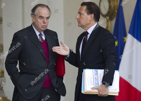 French Culture Minister Frederic Mitterrand (l) Speaks with French Energy and Industry Minister Eric Besson (r) As They Leave the Elysee Palace After the Weekly Cabinet Meeting in Paris France 16 November 2011 France Paris