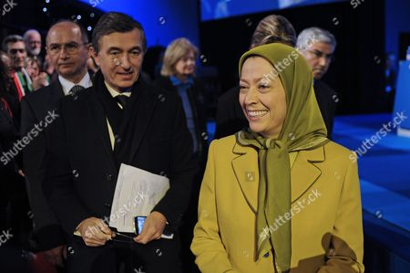 National Council of Resistance of Iran (ncr) Leader Maryam Rajavi (r) Arrives with Former French Foreign Affairs Minister Philippe Douste-blazy (l) at the 33rd Anniversary of the Iranian Revolution and the Seizure of Power by the Clerical Regime at Planet Equinox in Paris France 11 February 2012 France Paris