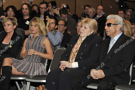 Colombian Singer Shakira (2-l) Waits with Her Parents Nidia Ripoll (2-r) and William Mebarak Chadid (r) to Be Honored Along with French Singer Patricia Kaas (l) by the French Minister of Culture and Communication During the 46th Midem in Cannes Southern France 28 January 2012 Shakira Received the Medal of Chevalier in the Order Arts and Letters and Kaas Received the Medal of Officer of the Order of Arts and Letters During the Ceremony the 46th Midem an International Record Music Publishing and Video Music Market Runs From 22 to 26 January France Cannes
