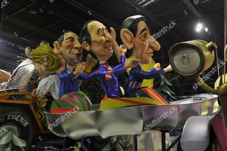 Carnival Characters Representing French Politicals (l-r : Francois Bayrou Francois Hollande and Nicolas Sarkosy) Are Pictured During the Preparations of the Carnival of Nice 2012 in Nice France 13 February 2012 the 128th Annual Carnival of Nice Which Will Run From 19 February to 04 March Will Celebrate the 'King of Sport' France Nice