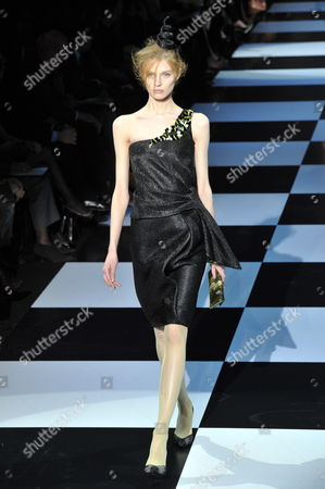 Stock Picture of Belarussian Model Olga Sherer Presents a Creation by Italian Designer Giorgio Armani During the Haute Couture Paris Fashion Week in Paris France 24 January 2012 the Presentation of the Spring-summer 2012 Haute Couture Collections Takes Place From 23 to 26 January France Paris