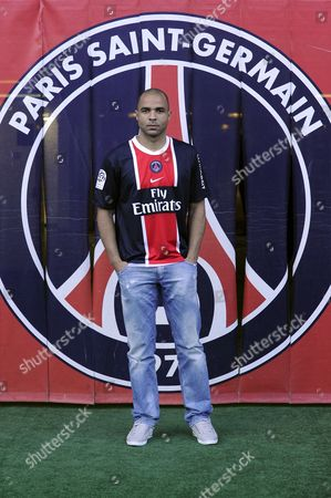 Brazilian Defender 'Alex' Aka Alex Rodrigo Dias Da Costa Wears His New Club's Jersey the French Ligue 1 Paris Saint-germain (psg) During His Presentation in Paris France 27 January 2012 the 29 Year-old Signed a Two-and-a-half-year Contract After Joining From English Side Chelsea Fc France Paris