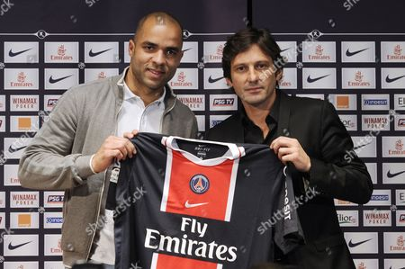 Brazilian Defender Alex (l) Aka Alex Rodrigo Dias Da Costa Flanked by French Ligue 1 Paris Saint-germain's Sporting Director Brazilian Leonardo (r) During Alex's Presentation in Paris France 27 January 2012 the 29 Year-old Signed a Two-and-a-half-year Contract After Joining From English Side Chelsea Fc France Paris
