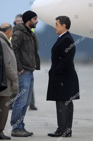 French President Nicolas Sarkozy (r) Speaks with French Journalist William Daniels (l) Upon the Latter's Arrival at the Villacoublay Military Airport Near Paris France 02 March 2012 William Daniels and His Colleague Edith Bouvier Were Evacuated by Plane From Lebanon After Escaping Homs Syria where They Were Injured by Syrian Government Forces in an Incident That Claimed the Lives of Their Colleagues Marie Colvin and Remi Ochlik on 22 February 2012 Bouvier Suffered Multiple Fractures in One of Her Legs France Villacoublay