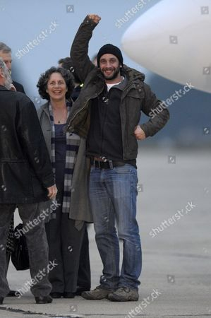 William Daniels Raises His Fist in Salute After Having Descended From a French Government Aircraft at the Villacoublay Military Airport Near Paris France 02 March 2012 Edith Bouvier and Daniels Were Evacuated by Plane From Lebanon After Escaping From Homs Syria where the Were Injured by Syrian Government Forces in Homs in an Incident That Claimed the Lives Colleagues Marie Colvin and Remi Ochlik on 22 February 2012 France Villacoublay