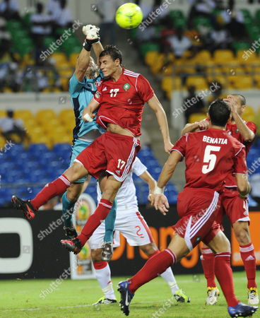 Goalkeeper Aymen Mathlouthi of Tunisia Punches Ball Away From Marouane Chamakh of Morocco During the Africa Cup of Nations Match Between Morocco and Tunisia in Libreville Gabon 23 January 2012 Gabon Libreville
