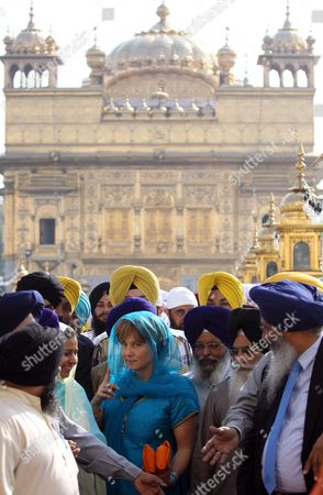 Christy Clark (c-in Blue Outfit) Premier of British Columbia Canada Comes out After Paying Obeisance at the Golden Temple the Holiest of Sikh Shrines in the Northern Indian City of Amritsar 16 November 2011 Christy Clark is Leading a British Columbia Government Trade Mission to India the University of British Columbia is Opening Two Offices in India As Part of Efforts to Gain a Foothold in One of the World's Most Rapidly Growing Higher Education Markets As Announced by Christy Clarke in Bangalore on 15 November India Amritsar