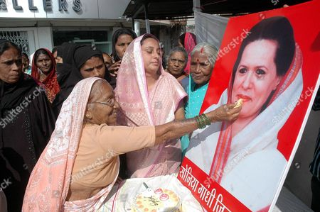 Stock Picture of Madhya Pradesh Congress Party Workers Celebrate the Birthday of Their Party President and United Progressive Alliance (upa) Chairperson Sonia Gandhi by Offering Sweets to Her Poster in Bhopal India 09 December 2011 Born Antonia Edvige Albina Maino in Veneto Italy on 09 December 1946 Sonia Gandhi was Married to the Former Prime Minister of India Rajiv Gandhi and She Has Been the Longest-serving President of the 125-year-old Indian National Congress India Bhopal