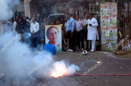 Stock Image of Madhya Pradesh Congress Party Workers Celebrate the Birthday of Their Party President and United Progressive Alliance (upa) Chairperson Sonia Gandhi by Burning Fire Crackers in Bhopal India 09 December 2011 Born Antonia Edvige Albina Maino in Veneto Italy on 09 December 1946 Sonia Gandhi was Married to the Former Prime Minister of India Rajiv Gandhi and She Has Been the Longest-serving President of the 125-year-old Indian National Congress India Bhopal