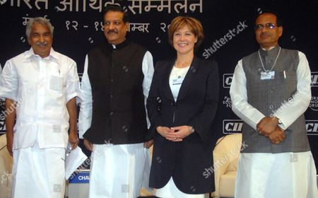 Oommen Chandy (l) Chief Minister of Kerala India Prithviraj Chavan (2l) Chief Minister of Maharashtra India Christy Clark (2r) Premier of British Columbia Canada and Shivraj Singh Chouhan (r) Chief Minister of Madhya Pradesh India Pose For Photograph During the Plenary Session on 'The New Role of the States: Catalysts For Growth' During the India Economic Summit 2011 in Mumbai India 14 November 2011 the World Economic Forum in Partnership with the Confederation of Indian Industry (cii) is Hosting Its Annual India Economic Summit For the First Time in Mumbai From the 12th to 14th of November Under the Working Theme Linking Leadership with Livelihood Over 800 Participants From 40 Countries Should Be Taking Part Epa/divyakant Solanki India Mumbai