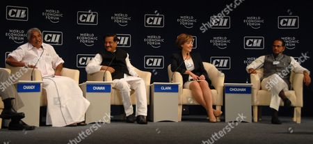Oommen Chandy (l) Chief Minister of Kerala India Speaks As Prithviraj Chavan (2-l) Chief Minister of Maharashtra India Christy Clark (2-r) Premier of British Columbia Canada and Shivraj Singh Chouhan (r) Chief Minister of Madhya Pradesh India Listen During the Plenary Session on 'The New Role of the States: Catalysts For Growth' During the India Economic Summit 2011 in Mumbai India 14 November 2011 the World Economic Forum in Partnership with the Confederation of Indian Industry (cii) is Hosting Its Annual India Economic Summit For the First Time in Mumbai From the 12th to 14th of November Under the Working Theme Linking Leadership with Livelihood Over 800 Participants From 40 Countries Should Be Taking Part Epa/divyakant Solanki India Mumbai