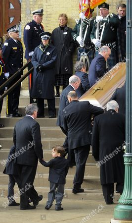 Former Chicago Mayor Richard M Daley Holds the Hands of Two Young Family Members As He Follows the Casket Containing the Body of His Wife Maggie Daley Into Old St Pat's Church During Funeral Serevices in Chicago Illinois Usa 28 November 2011 Daley Died 24 November After a Long Battle with Cancer Her Husband Served Six Four-year Terms at Mayor of Chicago Following in the Footsteps of His Father Richard J Daley United States Chicago