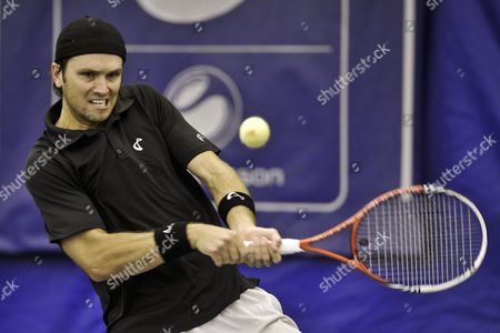Stock Photo of Robert Kendrick of the Us Hits a Return to Sergiy Stakhovsky of Ukraine During Their First Round Match in the Regions Morgan Keegan Championships in Memphis Tennessee Usa 21 February 2012 Stakhovsky Won the Match 6-3 7-7(6) United States Memphis