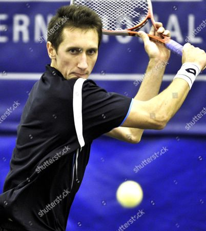 Stock Image of Sergiy Stakhovsky of Ukraine Eyes the Ball As He Hits a Return to Robert Kendrick of the Us During Their First Round Match in the Regions Morgan Keegan Championships in Memphis Tennessee Usa 21 February 2012 Stakhovsky Won the Match 6-3 7-7(6) United States Memphis