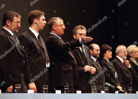 Belgrade Serbia Yugoslavia: Vojislav Seselj (3rd L) Chairman of the Ultra-nationalist Serbian Radical Party Welcomes Some Serbian Orthodox Priests in the Audience at the Beginning of a Party Congress in Belgrade on Sunday 23 January 2000 Seselj a Close Ally of Yugoslav President Slobodan Milosevic and the Entire Leadership of the Party Were Presiding the Fifth Congress of the Ultra-nationalist Party Today Seen (from L to R) Are Dragan Todorovic Aleksandar Vucic Chairman Seselj Tomislav Nikolic Nikola Poplasen and Maja Gojkovic the Highest Officials of the Serbian Radical Party; Others Are not Identified