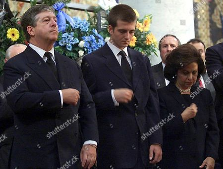 Topola-yugoslavia: Crown Prince Alexander Karadjordjevic of Yugoslavia (l) who Lives in Exile in London His Eldest Son Petar (c) and His Wife Katarina (r) Make the Sign of the Cross During Funeral Service of Prince Tomislav Karadjordjevic Member of Serbian Royal Family in King Petar i Karadjordjevic Memorial Monastery in Oplenac Near Topola Some 70 Km South of Belgrade on Sunday 16 July 2000 Prince Karadjordjevic the Uncle of Crown Prince Alexander Died of Cancer at the Age of 72 on Wednesday 12 July