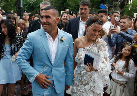 Soccer star Carlos Tevez and his wife Vanesa Mansilla exit the church after getting married in in Buenos Aires, Argentina