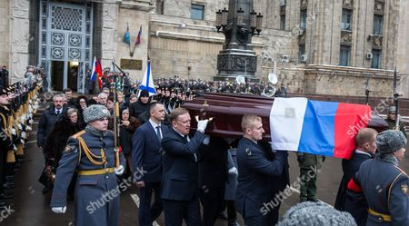 The coffin with the body of killed Russian ambassador to Turkey, Andrey Karlov, is carried out of the Russian Foreign Ministry building after a memorial service in Moscow, Russia,
