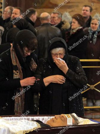 Maria Karlova (R), mother of killed Russian ambassador to Turkey, Andrey Karlov, attends a memorial service at the Christ the Savior Cathedral, in Moscow, Russia