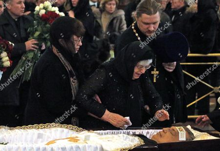 Maria Karlova (C) mother of killed Russian ambassador to Turkey, Andrey Karlov, attends a memorial service at the Christ the Savior Cathedral, in Moscow, Russia