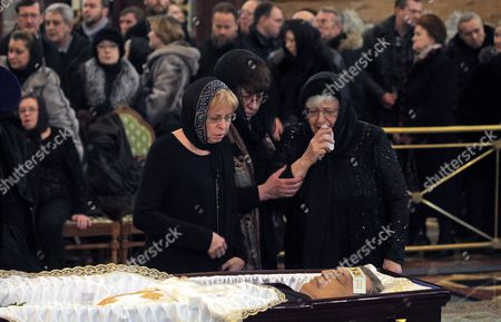 Marina Karlova (L), the widow of killed Russian ambassador to Turkey, Andrey Karlov, and his mother Maria (R) attend a memorial service at the Christ the Savior Cathedral, in Moscow, Russia