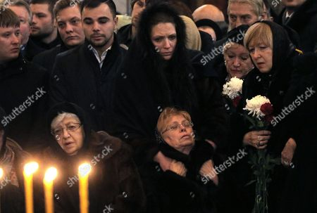 Marina Karlova (seated, R), the widow of killed Russian ambassador to Turkey, Andrey Karlov, and his mother Maria (seated, L) are surrounded by mourners as they attend a memorial service at the Christ the Savior Cathedral, in Moscow, Russia