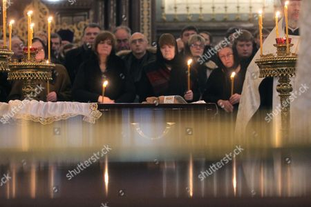 People stand behind the open coffin of killed Russian ambassador to Turkey, Andrey Karlov, as they attend a memorial service at the Christ the Savior Cathedral, in Moscow, Russia, 22 December 2016. Russia's ambassador to Turkey, Karlov was assasinated on 19 December during a culutural event at an art gallery in the Turkish capital by Turkish policeman Mevlut Mert Altintas, 22, who had been serving in Ankara's riot police for two years.