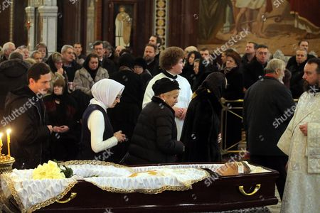 People pass by the open coffin of killed Russian ambassador to Turkey, Andrey Karlov, as they attend a memorial service at the Christ the Savior Cathedral, in Moscow, Russia, 22 December 2016. Russia's ambassador to Turkey, Karlov was assasinated on 19 December during a culutural event at an art gallery in the Turkish capital by Turkish policeman Mevlut Mert Altintas, 22, who had been serving in Ankara's riot police for two years.