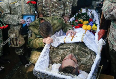 A comrade reacts during the funeral ceremony for the 'Kievskaya Rus' battalion serviceman Volodymyr Andreshkiv who was killed in the eastern Ukraine conflict at the Independence Square in Kiev, Ukraine, 22 December 2016. Secretary of the National Security and Defense Council of Ukraine Oleksandr Turchynov has announced that during recent battles near the town of Svitlodarsk the Armed Forces of Ukraine counter-attacked enemy troops, moved forward and took new positions as UNIAN agency report.