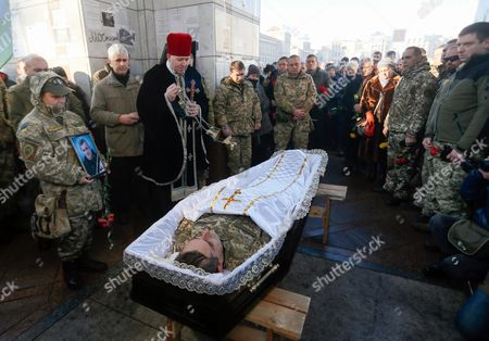 Ukrainian priest holds a service during the funeral ceremony for the â?Ë?Kievskaya Rusâ?? battalion serviceman Volodymyr Andreshkiv who was killed in the eastern Ukraine conflict at the Independence Square in Kiev, Ukraine, 22 December 2016. Secretary of the National Security and Defense Council of Ukraine Oleksandr Turchynov has announced that during recent battles near the town of Svitlodarsk the Armed Forces of Ukraine counter-attacked enemy troops, moved forward and took new positions as UNIAN agency report.