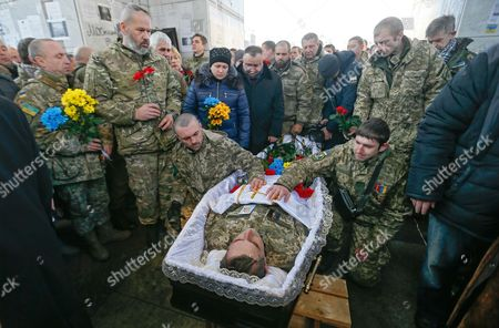 Comrades react during the funeral ceremony for the 'Kievskaya Rus' battalion serviceman Volodymyr Andreshkiv who was killed in the eastern Ukraine conflict at the Independence Square in Kiev, Ukraine, 22 December 2016. Secretary of the National Security and Defense Council of Ukraine Oleksandr Turchynov has announced that during recent battles near the town of Svitlodarsk the Armed Forces of Ukraine counter-attacked enemy troops, moved forward and took new positions as UNIAN agency report.