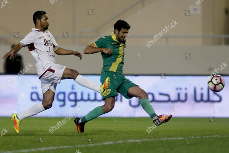 Al-Faisaly player Omar Abdulaziz (L) in action for the ball with Al-Khaleej player Abdullah Al-Salim (R) during the Saudi Professional League soccer match between Al Khaleej and Al-Faisaly at Prince Saud Bin Jalawi Stadium, Al-Khobar, Saudi Arabia, 22 December 2016.