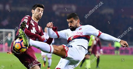 Stock Image of Torino's Benny Benassi (L) and Genoa's Tomas Rincon battle for the ball during the Italian Serie A soccer match Torino Fc vs Genoa Cfc at Olimpic Stadium in Turin, Italy, 22 December 2016.