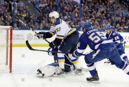 David Perron, Braydon Coburn St. Louis Blues left wing David Perron (57) celebrates after scoring against the Tampa Bay Lightning, including defenseman Braydon Coburn (55) during the first period of an NHL hockey game, in Tampa, Fla
