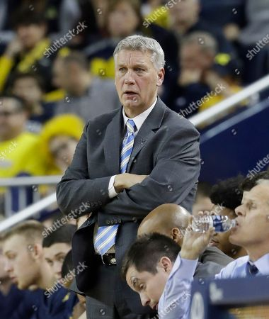 Michigan assistant coach Jeff Meyer watches during the second half of an NCAA college basketball game against Furman, in Ann Arbor, Mich