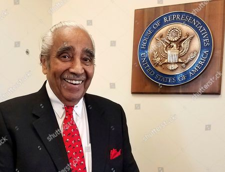 """U.S. Rep. Charles Rangel, D-NY, smiles in his New York office in Harlem after an interview with The Associated Press. Rangel thought he would be wrapping up his 46-year career in Congress on a note of triumph, leaving office at the same time as a history-making fellow Democrat, President Barack Obama, with the country in the hands of longtime friend Hillary Clinton. Instead, he said he is exiting to """"a nightmare,"""" the ascendancy of Donald Trump"""