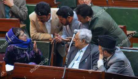 Jammu and Kashmir Main Opposition Peoples Democratic Party (pdp) Chief Patron Mufti Muhammad Sayeed (c-front) and Pdp President Mehbooba Mufti (l-front) Discussing with Pdp Members During a Budget Session at the Legislative Assembly in the Northern Indian City of Jammu the Winter Capital of Kashmir on 25 February 2012 Pdp Staged a Walk out Against State Government Over the State Accountability Commission Issued Notice to Chief Minister Omar Abdullah and Other Ministers Over Alleged Corruption Charges Seeking Explanation For Conferring Ministerial Status to Some Politicians and Thereby Illegally Entitling Them to Salaries and Perks India Jammu