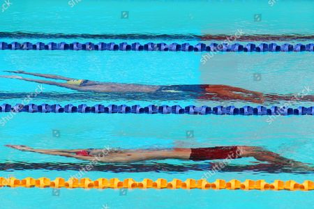 Thailand's Kanchanaudom Todsapoi (top) and Malaysia's Ian James Barr in Action During the 200 Meters Backstroke Competition at the 26th South East Asian (sea) Games in Palembang Indonesia 14 November 2011 Indonesia Palembang