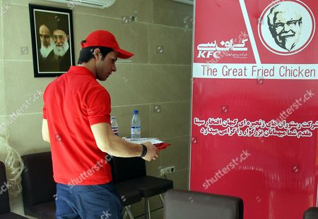 An Iranian Waiter Works at the Kfc Restaurant in the City of Karaj in the Alborz Province in Central Iran 27 February 2012 the American Fast Food Chain Restaurant Kentucky Fried Chicken Has Opened a Branch in Iran Despite Harsh Us Sanctions Against Iran Over That Country's Nuclear Programmes Iranian Media Reported on 25 February Amir-hossein Alizadeh the Licence Holder Said It Took Him Five Years to Get the Permission From Relevant Local Authorities to Re-open Kfc in Iran Kfc was Closed in Iran Following the 1979 Islamic Revolution Due to Its Affiliation with the Us the Country's Political Arch-enemy Epa/abedin Taherkenareh Iran (islamic Republic Of) Karaj