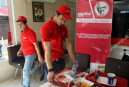 Iranian Waiters Work at the Kfc Restaurant in the City of Karaj in the Alborz Province in Central Iran 27 February 2012 the American Fast Food Chain Restaurant Kentucky Fried Chicken Has Opened a Branch in Iran Despite Harsh Us Sanctions Against Iran Over That Country's Nuclear Programmes Iranian Media Reported on 25 February Amir-hossein Alizadeh the Licence Holder Said It Took Him Five Years to Get the Permission From Relevant Local Authorities to Re-open Kfc in Iran Kfc was Closed in Iran Following the 1979 Islamic Revolution Due to Its Affiliation with the Us the Country's Political Arch-enemy Iran (islamic Republic Of) Karaj
