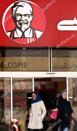 Stock Picture of Iranian Women Leave the Kfc Restaurant in the City of Karaj in the Alborz Province in Central Iran 27 February 2012 the American Fast Food Chain Restaurant Kentucky Fried Chicken Has Opened a Branch in Iran Despite Harsh Us Sanctions Against Iran Over That Country's Nuclear Programmes Iranian Media Reported on 25 February Amir-hossein Alizadeh the Licence Holder Said It Took Him Five Years to Get the Permission From Relevant Local Authorities to Re-open Kfc in Iran Kfc was Closed in Iran Following the 1979 Islamic Revolution Due to Its Affiliation with the Us the Country's Political Arch-enemy Iran (islamic Republic Of) Karaj