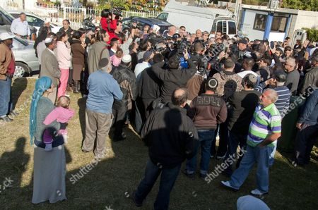 Former Israeli President Moshe Katsav Partially Visible (c) in a Mass of Television Cameras and Press Talks to Journalists For Some Minutes Outside His Home in Kiryat Malachi Israel 07 December 2011 As He Leaves to Go to a Prison in Ramle and Begin Serving His Seven Year Sentence Katsav was Convicted For Rape and Sexual Assault and Continues to Declare His Innocence Neighbors and Supporters Also Came out to See Him and Show Their Support As He was Driven to Prison Israel Kiryat Malachi