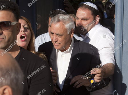 Former Israeli President Moshe Katsav (c) Surrounded by Friends and Security Leaves His Home in Kiryat Malachi Israel to Go to Prison For Rape Conviction 07 December 2011 Katsav Has Been Sentenced to Seven Years For Rape and Sexual Assault and Continues to Declare His Innocence Israel Kiryat Malachi