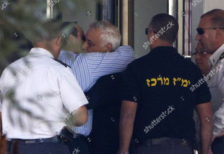 Stock Image of Former Israeli President Moshe Katsav Hugs One of His Sons As He Enters a Prison in Ramle Outside Tel Aviv Israel 07 December 2011 Katsav was Sentenced to Seven Years in Jail After He Had Previously Been Found Guilty of Rape and Other Sexual Offenses Israel Ramle