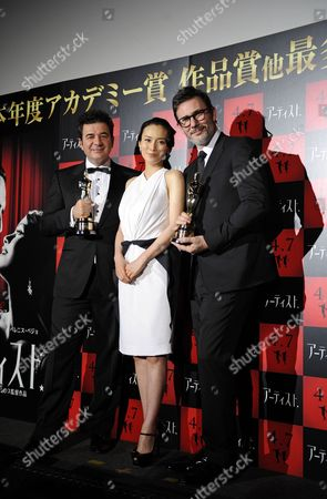 Oscar-winners French Composer Ludovic Bource (l) and French Film Director Michel Hazanavicius (r) Pose with Japanese Actress Miki Nakatani (c) During a Press Event Promoting Hazanavicius' Latest Movie 'The Artist' in Tokyo Japan 08 March 2012 'The Artist' Will Be Screened Across Japan From 07 April Japan Tokyo